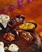 Various Indian chutneys in wooden bowls