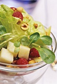 Mixed salad leaves with fresh fruit and nuts