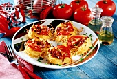 Baked pasta nests with ham and tomato filling