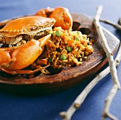 Cooked crab on vegetable rice