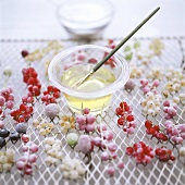 Painting redcurrants with egg white
