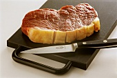 Scoring the fat on rump steak