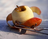 Apple with peeler