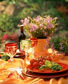Laid tables with tomatoes and basil in open air
