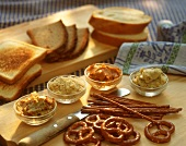 Salted biscuits, spreads and slices of bread for buffet