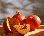 Hokkaido pumpkins, whole and cut open