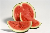 Wedge of watermelon and half a watermelon