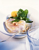Redfish fillet with spinach and hazelnut butter