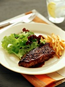 Peppered steak with chips and salad