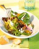 Mixed salad leaves with mirabelles & fresh goat's cheese