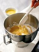 Folding in beaten egg white (making a sponge cake)