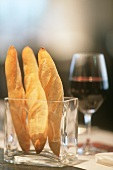 Bread sticks and a glass of red wine
