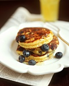 Pancake with blueberries and rosewater and honey syrup