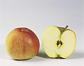 One half and one whole Braeburn apple