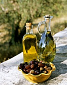 Olive oil with olives in open air