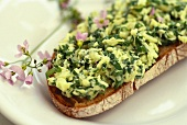 Open herb cheese sandwich