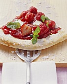 A piece of berry pizza (yeast cake with berries)