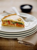 Spicy vegetable pie with bacon, eggs and herbs