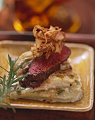 Kohlrabi gratin with lamb fillet and fried onions