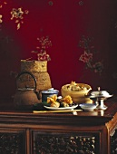 Chinese table scene with dim sum and tea