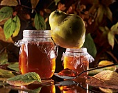 Two jars of quince jelly and one quince