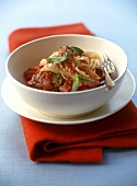 Pasta with tomato and onion sauce, sausage meat and mint