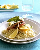 Turkey escalope with ham and sage on lemon risotto