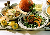 Raw pumpkin and apple salad and fried pumpkin with olive paste