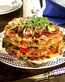 Baked pancake tower with vegetables and mince