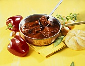 Beef goulash; fresh peppers; bread roll
