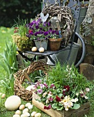 Easter decoration (flowerpots, wreaths, eggs) in garden