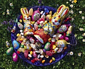 Bowl of Easter sweets in the meadow