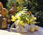 Bouquet of flowers in delicate yellow & white; Easter figures