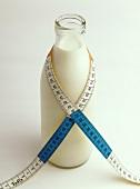 Milk bottle with tape measure (centimetre)