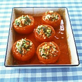 Stuffed tomatoes with rice, courgettes and herbs
