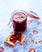 Strawberry jam on toast and in preserving jar
