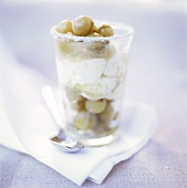 Layered sundae with yoghurt ice cream and gooseberry compote
