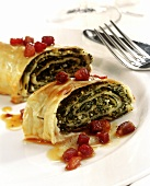 Savoury strudel with kale filling and diced bacon