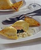 Salmon and spinach pierogi (pasties) with horseradish