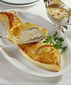 Loup de mer (sea bass) with salmon stuffing in puff pastry