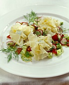 Filled ruffle of Tete-de-Moine cheese on vegetable salad