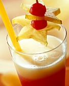 Tropical Heat, garnished with carambola & cherry on stick