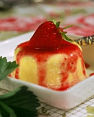 Turned-out vanilla cream with strawberry sauce