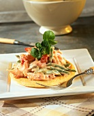 Blini with crab and bean salad