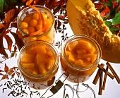 Bottled pumpkin in jars and a slice of pumpkin