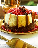 Madeira cake charlotte with chocolate and pomegranate seeds