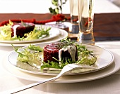 Beetroot in aspic with sour cream sauce and curly endive