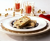 Vanilla ice cream with spekulatius, fruit, pistachios