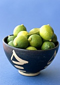 Limequats (mini-limes) in a bowl