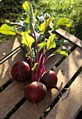 Beetroot on wooden crate in open air